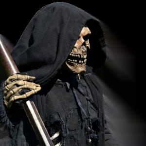 halloween specter of death grim reaper holding scythe